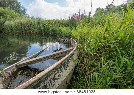 Old Steel Rowboat Filled With Water