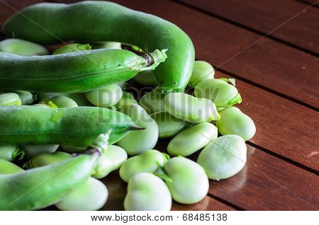 Closeup Of Broad Bean On Wooden Table