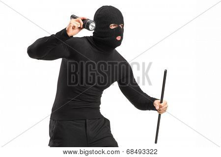 Robber with mask holding a flashlight and piece of pipe isolated on white background
