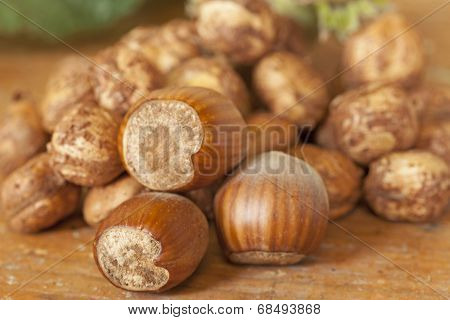 Hazelnut shells on wooden table top