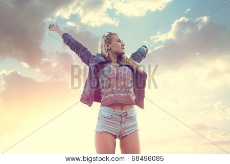 Free happy romantic woman in happiness bliss  with opened arms enjoying the sunset summer evening na