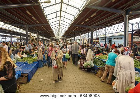 Local Shoppers Buy Vegetables