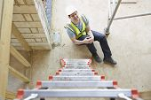 pic of worker  - Construction Worker Falling Off Ladder And Injuring Leg - JPG