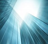 stock photo of high-rise  - Abstract illustration background texture of perspective wide angle view to steel light blue glass surface - JPG