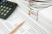 image of receipt  - Stack of sales and receipt on finance account with pencil and black calculator - JPG