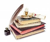 image of inkpot  - Old books candle in candlestick feather in inkpot and scroll with stamp - JPG