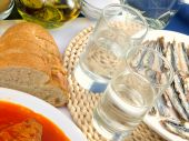foto of ouzo  - Greek ouzo or tsipouro with misc seafood - JPG