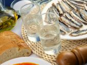 picture of ouzo  - Greek ouzo or tsipouro with misc seafood - JPG