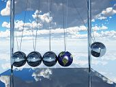 stock photo of newton  - Newtons Cradle Earth Elements of this image furnished by NASA - JPG