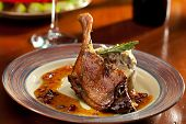 stock photo of roast duck  - Duck Legs with Mashed Potato - JPG