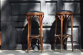 picture of stool  - Two vintage wooden bar stools in the pub - JPG