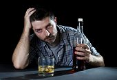 foto of alcohol abuse  - grunge wasted alcoholic man drunk at the table holding whiskey bottle in alcohol addiction and alcoholism concept - JPG