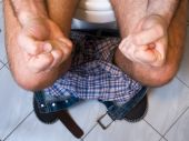 stock photo of defecate  - The metaphor of gastrointestinal problems like constipation or diarrhea - JPG