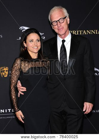 LOS ANGELES - OCT 30:  Julia Louis-Dreyfus & Brad Hall arrives to the BAFTA Jaguar Brittannia Awards 2014 on October 30, 2014 in Beverly Hills, CA