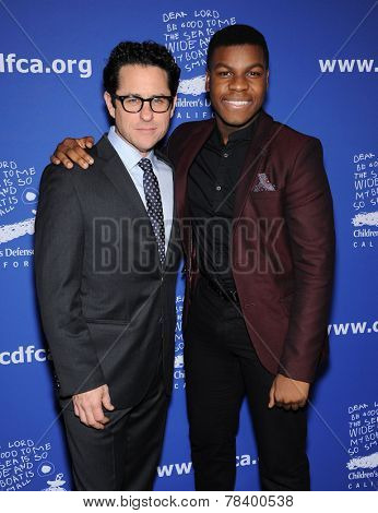 LOS ANGELES - DEC 04:  J.J. Abrams & John Boyega arrives to the 2014 Beat The Odds on December 04, 2014 in Culver City, CA