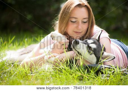 Dog and owner on the grass