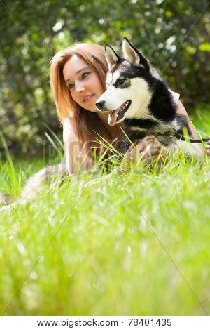 Portrait Of Husky Dog And Female Owner