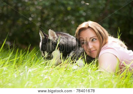 Draming Girl With Her Husky