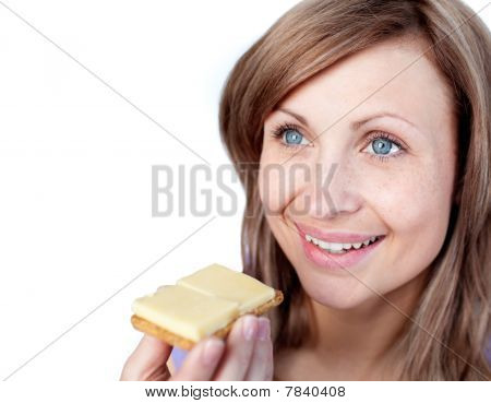 Cheerful Woman Eating A Cracker With Cheese
