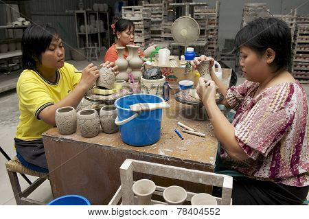 Women cut traditional tattoo motives decoration at kaolin, Kuching, Malaysia.