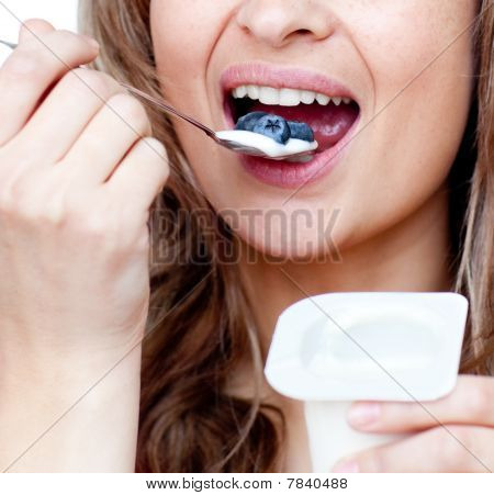 Close-up Of A Woman Eating A Yogurt