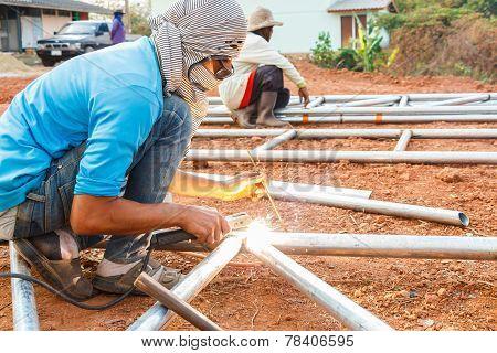 Welder With Turban Is Welding