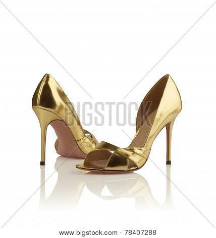 Pair of golden women shoes