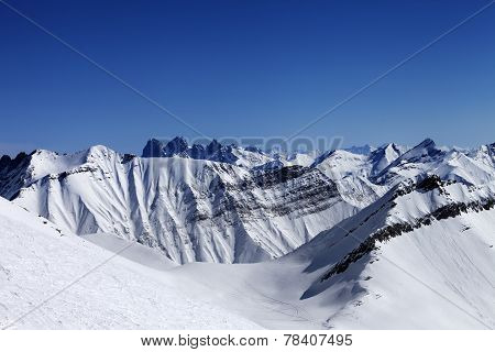 Off-piste Slope In Sun Day And Traces Of Avalanches, Ski And Sno