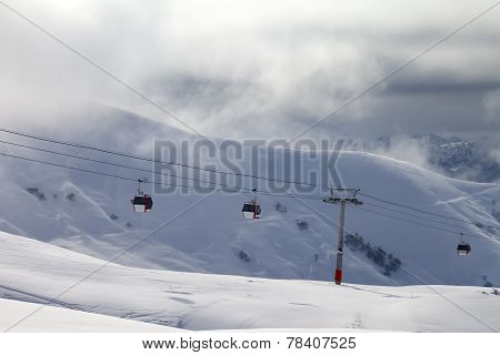 Gondola Lifts And Off-piste Slope In Mist