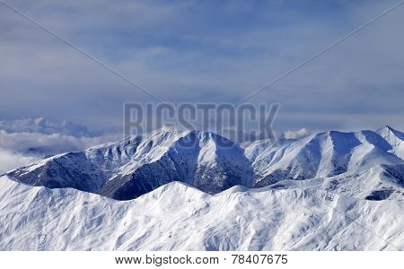 Winter Mountains In Clouds At Windy Day