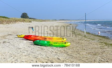 Brightly coloured pedalos Studland knoll beach Dorset England UK