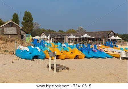 Brightly coloured pedalos Studland knoll beach Dorset England UK