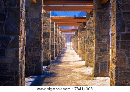 Pedestrian path with stone wall perspective