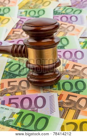 gavel and euro banknotes. symbolic photo for costs in court, rule of law and auctions