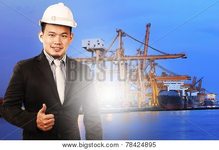 Young Manager Man Standing And Sign Good Quality Control Of Port Shipping Import Export And Logistic