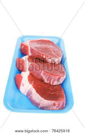 fresh meat : raw uncooked fat lamb pork fillet mignon loin on blue tray isolated over white background