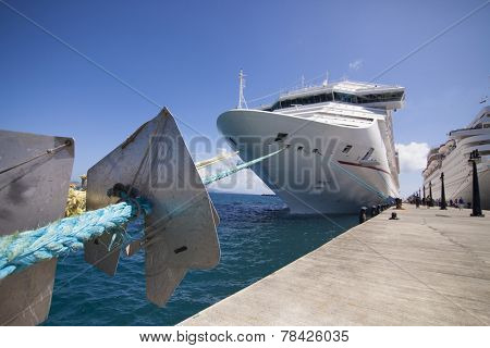 wide angle view of cruise ship in port, focus on foreground