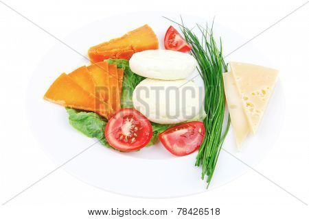 fresh aged cheese : parmesan roquefort and gruyere with soft feta on plate with isolated over white background
