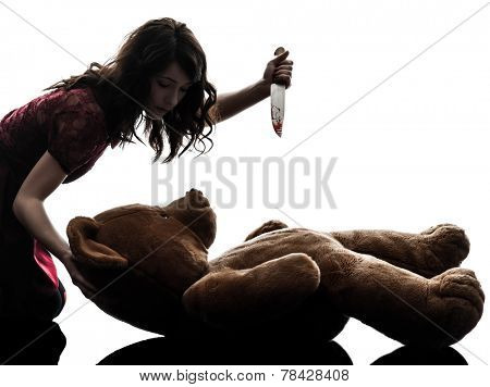 one  strange young woman killing her teddy bear in silhouette white background