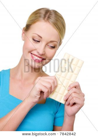 Woman Wishes To Eat A Tile Of  Chocolate