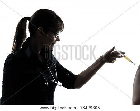 one woman doctor holding surgical needle vaccination silhouette studio isolated on white background