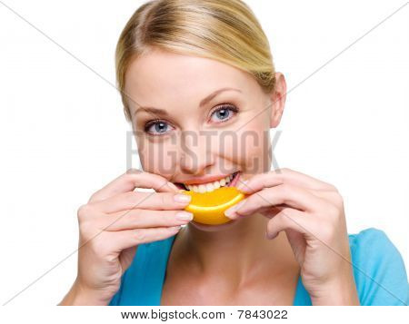 Smiling Adult Girl Eats The Fresh Orange