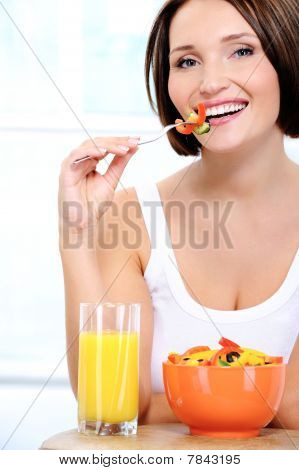 Cheerful Young Woman Has Breakfast
