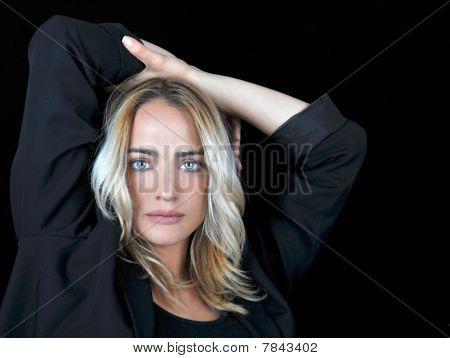 Gorgeous woman on black background.