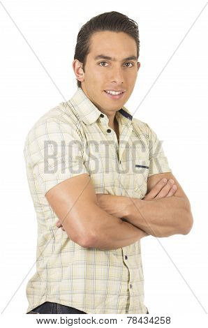 young handsome hispanic man posing with arms crossed
