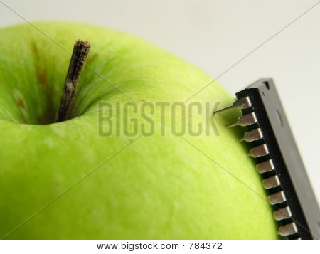 Chip-attack on green apple!