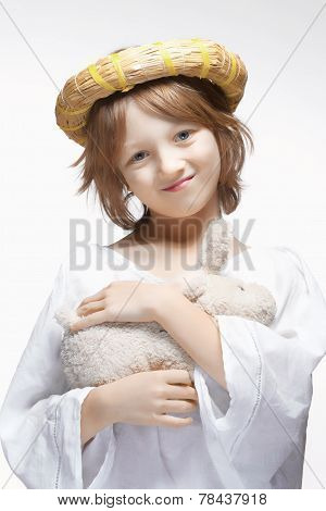Portrait Of A Boy With Wreath And Stuffed Animal