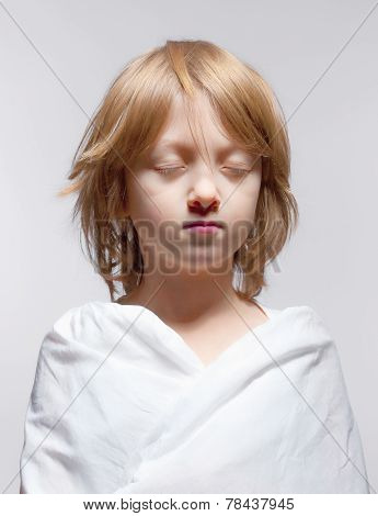 Portrait Of A Boy With Closed Eyes - Isolated On Gray