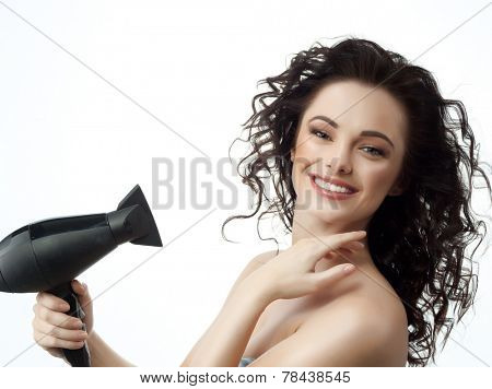 portrait of attractive  caucasian woman  with long blond hair isolated on white studio shot making hairstyle with hair drier