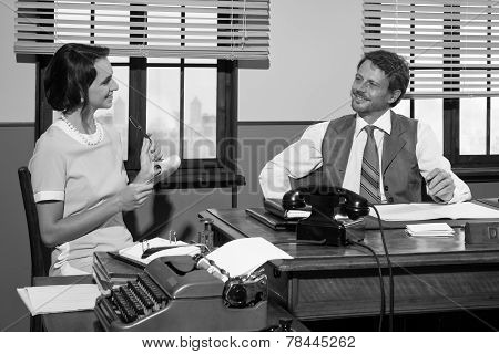 Vintage Director And Secretary Working Together At Desk